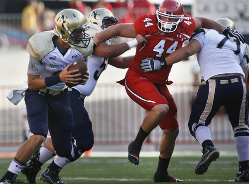 Scott Sommerdorf  |  The Salt Lake Tribune              Utah DT Dave Kruger tries to get past the No. Colo. offensive line during first quarter play. Utah held a 7-0 lead over Northern Colorado early in the second quarter on Jordan Wynn's 10 yard TD pass to Jake Murphy, Thursday, August 30, 2012.