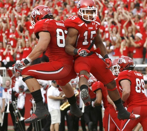 Paul Fraughton | The Salt Lake Tribune Tight end Jake Murphy and  John White celebrate White's first touchdown in the second quarter against Northern Colorado at Rice Eccles Stadium in Salt Lake City on Thursday, Aug. 30, 2012.