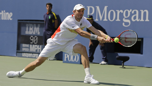 Mardy Fish returns a shot to Russia's Nikolay Davydenko in the second round of play at the 2012 US Open tennis tournament,  Thursday, Aug. 30, 2012, in New York. (AP Photo/Mike Groll)
