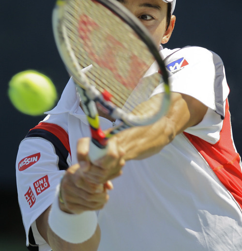 Japan's Kei Nishikori returns a shot to Tim Smyczek in the second round of play at the 2012 US Open tennis tournament,  Thursday, Aug. 30, 2012, in New York. (AP Photo/Kathy Willens)