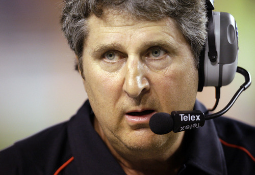 FILE - In this Sept. 19, 2009, file photo, Texas Tech coach Mike Leach waits as a play is reviewed during the first quarter of their NCAA college football game against Texas in Austin, Texas. Leach has reached a verbal agreement to be the new football coach at Washington State, an official within the athletic department told the Associated Press on Wednesday, Nov. 30, 2011. (AP Photo/Eric Gay, File)