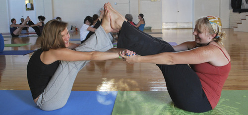 Courtesy photo Attendees of a Partner Yoga class in 2011. The class will be offered during the 2012 Great Salt Lake Yoga Fest from Sept. 1-3 at the Krishna Center in Salt Lake City.