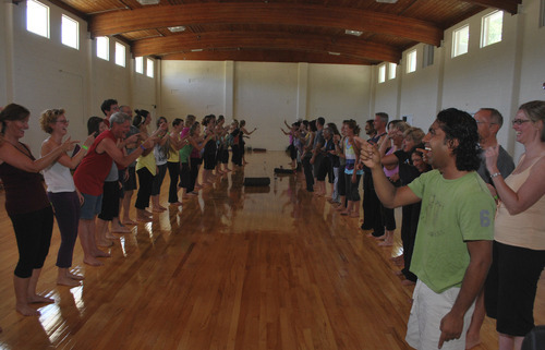 Courtesy photo Santosh Maknikar, right, leads attendees in a Laughing Yoga workshop in 2011. The popular class will be held during the 2012 Great Salt Lake Yoga Fest, scheduled from Sept. 1-3 at the Krishna Center in Salt Lake City.