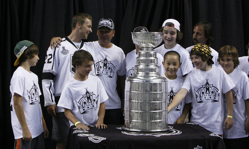 Francisco Kjolseth  |  The Salt Lake Tribune Members of the Park City Ice Miners get a chance to meet Trevor Lewis, second from left, who played hockey for Brighton High School as he brings the Stanley Cup home for a day as a member of the NHL champion Los Angeles Kings. Thousands of fans lined up at the Maverik Center in West Valley City on Thursday, August 30, 2012, for a chance to pose for a picture with Lewis and the Cup.