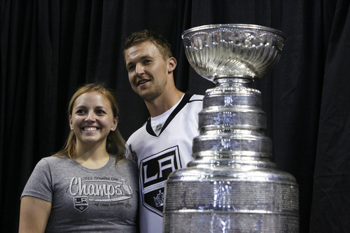 Francisco Kjolseth  |  The Salt Lake Tribune Toriann Holmes, of West Jordan, relishes the chance to pose for a picture with Trevor Lewis, who played hockey for Brighton High School, as he brings the Stanley Cup home for a day as a member of the NHL champion Los Angeles Kings. Thousands of fans lined up at the Maverik Center in West Valley City on Thursday, August 30, 2012, for a chance to pose for a picture with Lewis and the Cup.