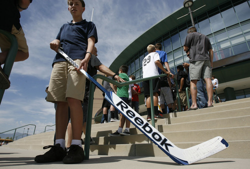 Francisco Kjolseth  |  The Salt Lake Tribune Howie Rylant, 13, packs his hockey stick in hopes of getting it autographed by Trevor Lewis, who played hockey for Brighton High School, as he brings the Stanley Cup home for a day as a member of the NHL champion Los Angeles Kings. Thousands of fans lined up at the Maverik Center in West Valley City on Thursday, August 30, 2012, for a chance to pose for a picture with Lewis and the Cup.