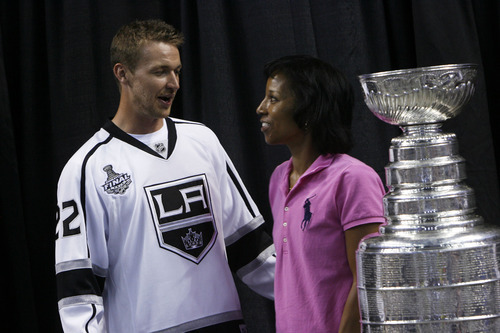 Francisco Kjolseth  |  The Salt Lake Tribune Tami Long, of Salt Lake City, meets Trevor Lewis, who played hockey for Brighton High School, as he brings the Stanley Cup home for a day as a member of the NHL champion Los Angeles Kings. Thousands of fans lined up at the Maverik Center in West Valley City on Thursday, August 30, 2012, for a chance to pose for a picture with Lewis and the Cup.