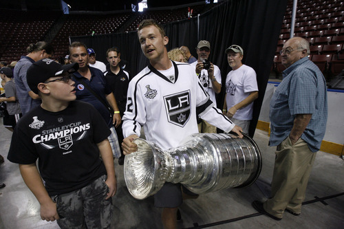 Francisco Kjolseth     The Salt Lake Tribune Trevor Lewis, who played hockey for Brighton High School, brings the Stanley Cup home for a day as a member of the NHL champion Los Angeles Kings. Thousands of fans lined up at the Maverik Center in West Valley City on Thursday, August 30, 2012, for a chance to pose for a picture with Lewis and the Cup.