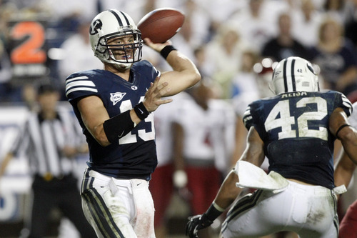 Chris Detrick  |  The Salt Lake Tribune BYU quarterback Riley Nelson throws the ball during the second half of the game against Washington State at LaVell Edwards Stadium in Provo on Thursday, Aug. 30, 2012. BYU won the game 30-6.