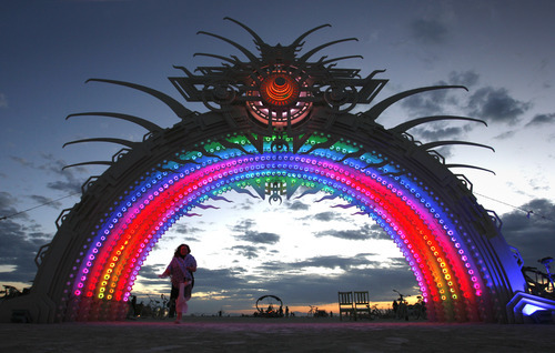 Rick Egan  |  The Salt Lake Tribune  A woman enters the arch at center camp before sunrise at Burning Man, the annual arts festival in the Black Rock Desert in Nevada, Thursday, August 30, 2012.