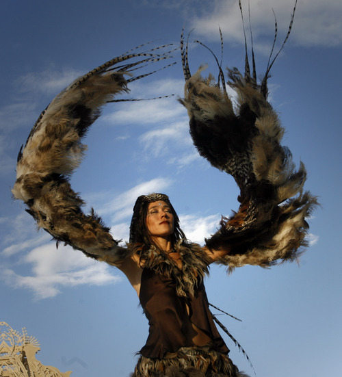 Rick Egan  |  The Salt Lake Tribune  Ildie dances with feathers at Burning Man, the annual arts festival in the Black Rock Desert in Nevada.