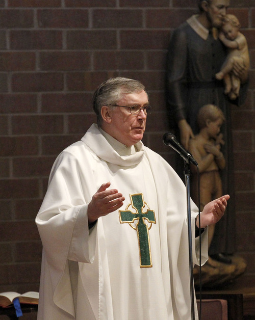 Al Hartmann  |  The Salt Lake Tribune Monsignor Francis Mannion is retiring. Here, he conducts Mass at St. Vincent de Paul Catholic Church on Wednesday, Aug. 22.