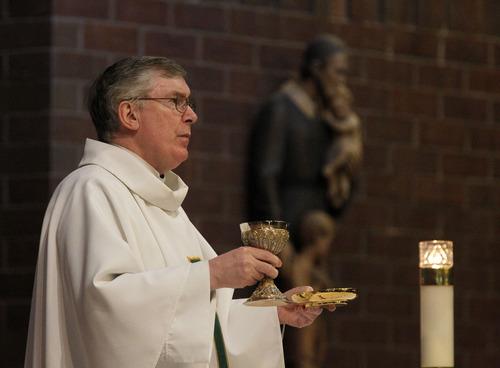Al Hartmann  |  The Salt Lake Tribune Monsignor Francis Mannion is retiring. Here, he conducts Mass at St. Vincent de Paul Catholic Church on Wednesday, Aug. 22.