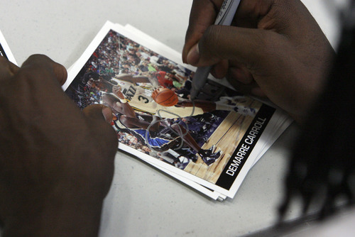 Francisco Kjolseth  |  The Salt Lake Tribune Everyone gets something as Jazz forward DeMarre Carroll signs pictures and whatever else kids were looking to have signed to mark the occasion as he participates in Junior Jazz at the Trojan Century Center in Morgan, Utah on Monday, August 6, 2012. Dozens of boys and girls from all age groups had a chance to learn about the 6'8