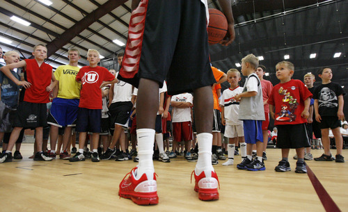 Francisco Kjolseth  |  The Salt Lake Tribune Jazz forward DeMarre Carroll participates in Junior Jazz at the Trojan Century Center in Morgan, Utah on Monday, August 6, 2012. Dozens of boys and girls from all age groups had a chance to learn about the 6'8