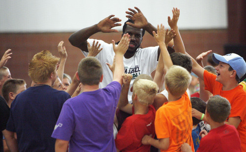 Francisco Kjolseth  |  The Salt Lake Tribune Kids high-five Jazz forward DeMarre Carroll during a Junior Jazz event at the Trojan Century Center in Morgan on Monday, Aug. 6, 2012.