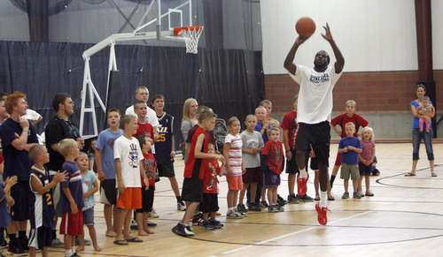 Francisco Kjolseth  |  The Salt Lake Tribune Kids watch in anticipation to see if Jazz forward DeMarre Carroll can make a basket from half court as he participates in Junior Jazz at the Trojan Century Center in Morgan, Utah on Monday, August 6, 2012. Dozens of boys and girls from all age groups had a chance to learn about the 6'8