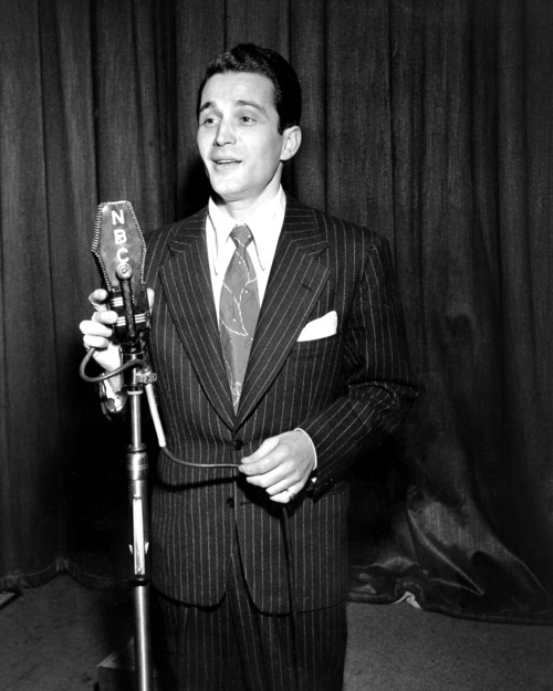 FILE - In this Feb. 20, 1945 file photo, Perry Como sings during his radio broadcast of