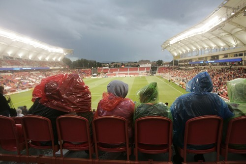 Kim Raff | The Salt Lake Tribune Fans brave a thunder shower that delayed the Real Salt Lake and D.C. United game at Rio Tinto Stadium in Sandy, Utah on September 1, 2012.