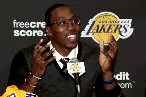 Dwight Howard, newly acquired by the Los Angeles Lakers from the Orlando Magic, speaks during a team NBA basketball news conference, Friday, Aug. 10, 2012, in El Segundo, Calif. (AP Photo/Los Angeles Times, Anne Cusack)