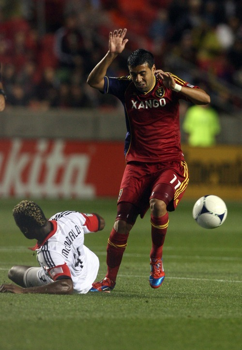 Kim Raff | The Salt Lake Tribune (right) Real Salt Lake Javier Morales #11dribbles past D.C. United player Brandon McDonald during a game at Rio Tinto Stadium in Sandy, Utah on September 1, 2012.