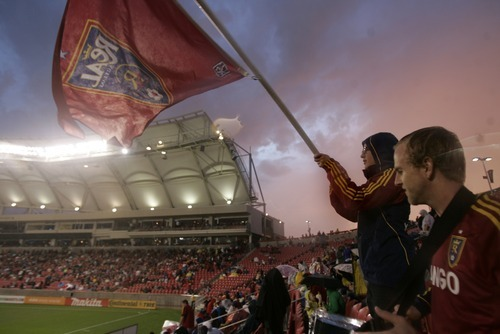Kim Raff | The Salt Lake Tribune (right) Preston Butcher and Roger Machado stand in a thunderstorm during a rain delay and wait for the game between Real Salt Lake and D.C. United to resume at Rio Tinto Stadium in Sandy, Utah on September 1, 2012.