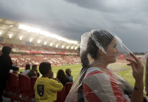 Kim Raff | The Salt Lake Tribune Real Salt Lake fan Katie Zampedri waits for a thunderstorm to pass that delayed the game against D.C. United at Rio Tinto Stadium in Sandy, Utah on September 1, 2012.