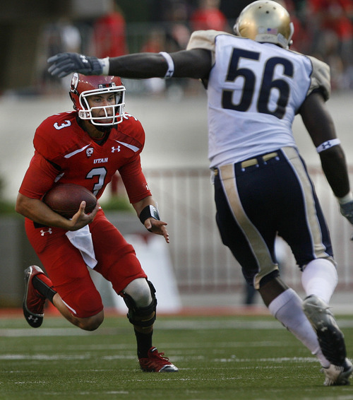 Scott Sommerdorf  |  The Salt Lake Tribune              Utah QB Jordan Wynn scrambles for yardage during first half play. Defending fvor No. Colo. is LB Clarence Bumpas. Utah held a 7-0 lead over Northern Colorado early in the second quarter on Jordan Wynn's 10 yard TD pass to Jake Murphy, Thursday, August 30, 2012.