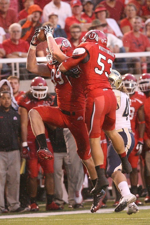 Paul Fraughton | The Salt Lake Tribune  Ute defensive end Joe Kruger makes an interception that he ran into the end zone for a Utah touchdown against Northern Colorado at Rice Eccles Stadium in Salt Lake City on Thursday, Aug. 30, 2012.