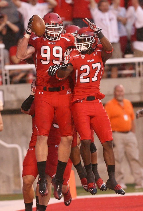 Paul Fraughton | The Salt Lake Tribune Joe Kruger  and Tyron Morris-Edwards celebrate Kruger's interception that he ran in for a   touchdown against Northern Colorado at Rice Eccles Stadium in Salt Lake City on Thursday, Aug. 30, 2012.