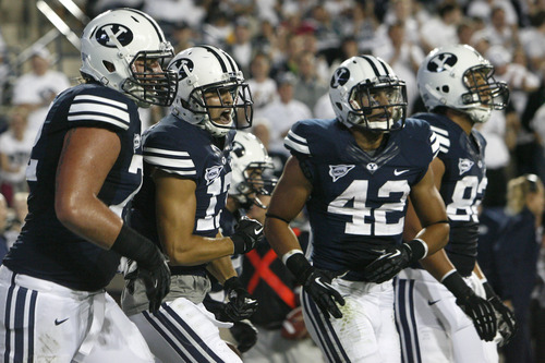 Chris Detrick  |  The Salt Lake Tribune Brigham Young Cougars wide receiver Skyler Ridley (17) celebrates after scoring a touchdown during the first half of the game against Washington State at LaVell Edwards Stadium Thursday August 30, 2012. BYU is winning the game 24-6.