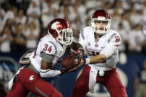 Kim Raff | The Salt Lake Tribune Washington State Cougars quarterback Jeff Tuel (10) hands the ball off to Washington State Cougars running back Teondray Caldwell (34)during BYU's home opener at LaVell Edwards Stadium in Provo, Utah on August 30, 2012.