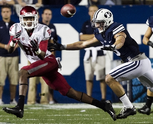 Washington's Marquess Wilson makes a reception as BYU's Daniel Sorensen tries to break up the pass during the first half of the NCAA college football game between the BYU Cougars and the Washington State Cougars at LaVell Edwards Stadium in Provo, Utah on Thursday, Aug. 30, 2012. (AP Photo/Spenser Heaps, Daily Herald)
