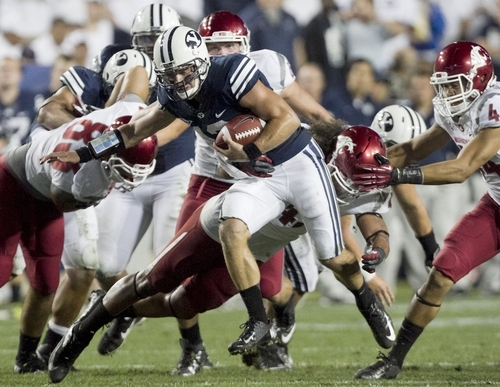 BYU quarterback Riley Nelson runs the ball during the first half of the NCAA college football game between the BYU Cougars and the Washington State Cougars at LaVell Edwards Stadium in Provo, Utah on Thursday, Aug. 30, 2012. (AP Photo/Spenser Heaps, Daily Herald)
