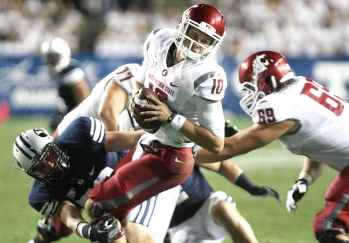 Kim Raff | The Salt Lake Tribune Washington State Cougars quarterback Jeff Tuel (10) is sacked by Brigham Young Cougars defensive lineman Remington Peck during BYU's home opener at LaVell Edwards Stadium in Provo, Utah on August 30, 2012.