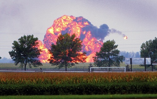 A fiery piece of a L-39 jet plane, catapults away from the main fireball, Saturday, September 1, 2012, after it crashed during the Quad-City Air Show in Mt. Joy, Iowa,  Saturday September 1, 2012.  A plane that was part of an air show in eastern Iowa has crashed, and authorities say the pilot was killed. (AP Photo/The Quad City Times, Kevin E. Schmidt) MAGS OUT; NO SALES; TV OUT; MOLINE DISPATCH OUT