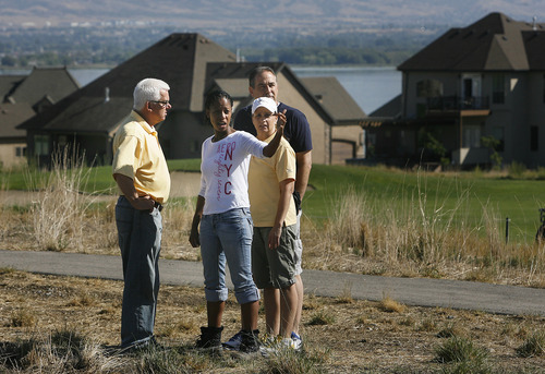 Scott Sommerdorf  |  The Salt Lake Tribune              Saratoga Springs Mayor Mia Love speaks with city workers, Sunday, September 2, 2012 about homes damaged by muddy runoff from the overnight flood.