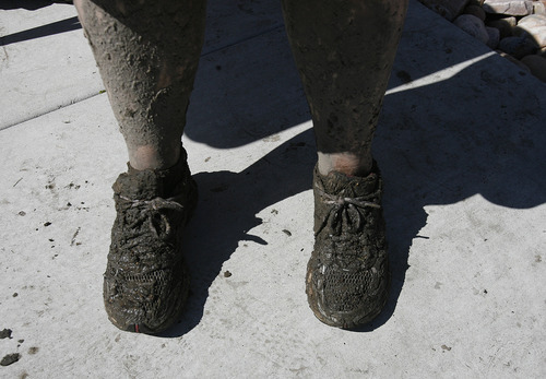 Scott Sommerdorf  |  The Salt Lake Tribune              Karin Robe's feet show the effects of volunteering to help clean out homes  affected by the flood near the intersection of Appaloosa and Weatherby Drives in Saratoga Springs, Sunday, September 2, 2012.