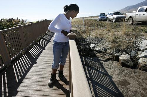 Scott Sommerdorf  |  The Salt Lake Tribune              Saratoga Springs Mayor Mia Love looks at a culvert off Redwwod Road, Sunday, September 2, 2012 blocked by muddy runoff from the overnight flood.