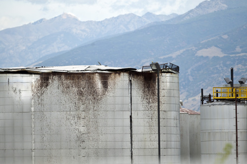 Chris Detrick  |  The Salt Lake Tribune HollyFrontier refinery' s damaged oil storage tank in Woods Cross Saturday September 1, 2012. Thursday night,  a large metal oil storage tank's roof burst at the HollyFrontier refinery in Woods Cross. The eruption sent a swath of oil about a 40 yards wide and traveling through the air over Interstate 15 and up to 1 mile southeast of the refinery. An estimated 8,400 gallons of oil landed on homes, businesses and cars in Woods Cross, West Bountiful and Bountiful. The refinery sits 393 S. 800 West in Woods Cross.