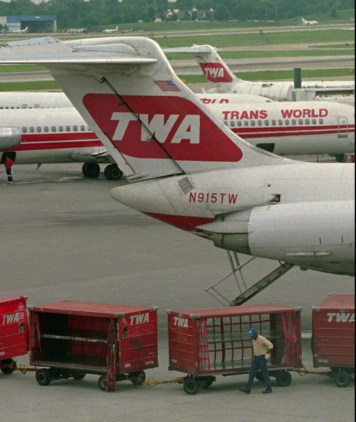 (AP PHOTO/Jane Rudolph)  American Airlines bought St. Louis-based TWA just months before the 9/11 hijackings. In the subsequent downturn, American slashed 2,500 jobs, and TWA attendants, who had lost their seniority in the takeover, were the first to be cut.