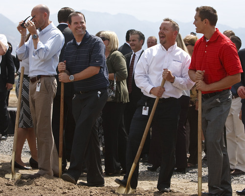 Leah Hogsten  |  The Salt Lake Tribune Xactware Solution's Inc. employees (from left) Brandon Harding, Brian Carroll, Scott Parkin and Michael Gratzinger take their turns shoveling dirt at a recent groundbreaking for the company's new office building in Lehi.