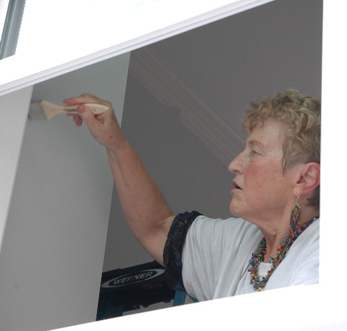 Karen McCoy, a retired Veterans Administration employee and a Utah delegate to the Democratic National Convention, paints the kitchen of a home that will be donated to a veteran. Photo by Leah Bryner.