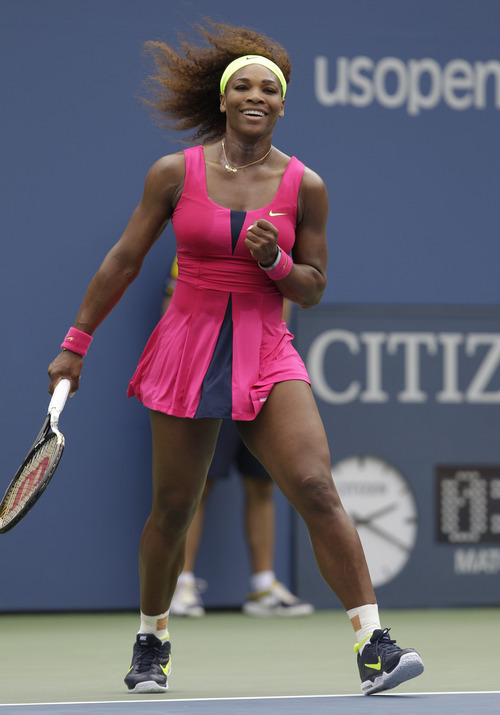 Serena Williams reacts after winning her match against Czech Republic's Andrea Hlavackova in the fourth round of play at the 2012 US Open tennis tournament,  Monday, Sept. 3, 2012, in New York. (AP Photo/Kathy Willens)