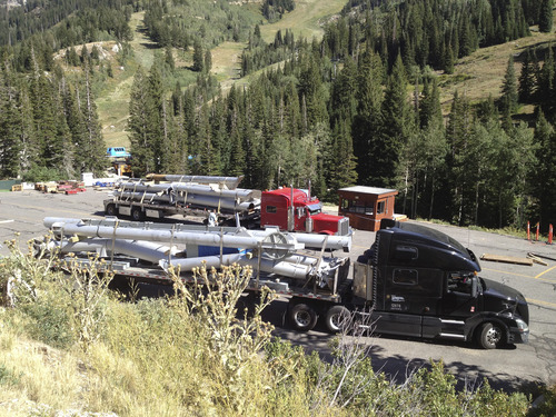 The old Little Cloud lift, a fixed-grip two-seater that is being replaced by a high speed quad chair, was loaded onto flatbed trucks that will take it to Hunt Hollow Resort in western New York. Courtesy Snowbird Ski & Summer Resort