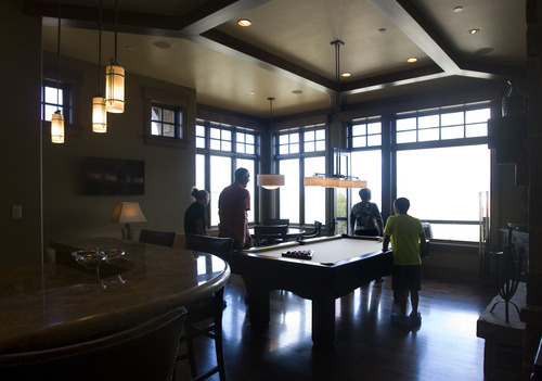 Kim Raff    The Salt Lake Tribune People tour the entertainment room of the 5,022-square-foot home on Aspen Camp Loop in the Promontory in Park City Utah during the Park City Showcase of Homes on September 2, 2012.