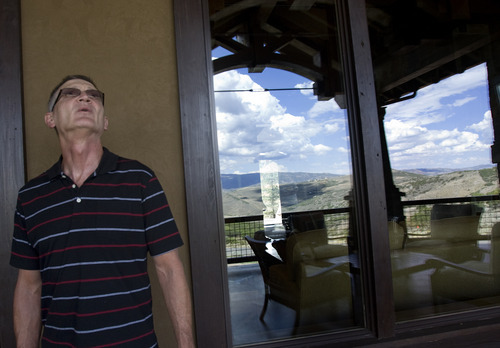 Kim Raff |  The Salt Lake Tribune Norman Ritchie admires the balcony of the 5,022-square-foot home on Aspen Camp Loop in the Promontory in Park City Utah during the Park City Showcase of Homes on September 2, 2012.
