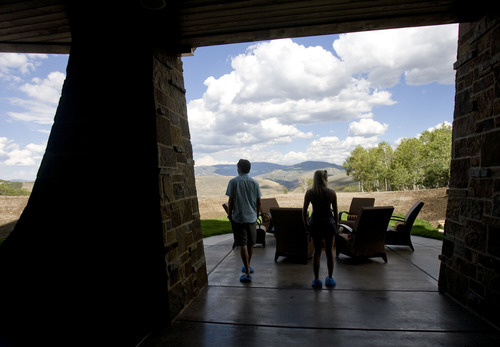 Kim Raff |  The Salt Lake Tribune Adam and Debbie O'Neill walk onto the patio in the basement of the 5,022-square-foot home on Aspen Camp Loop in the Promontory in Park City Utah during the Park City Showcase of Homes  on September 2, 2012.