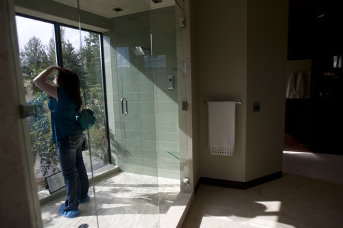 Kim Raff | The Salt Lake Tribune Karen Clayson steps into the shower in the master bathroom in the 7,173-square-foot house on Mountain Top Lane in Park City, Utah during the Park City Showcase of Homes on September 2, 2012.