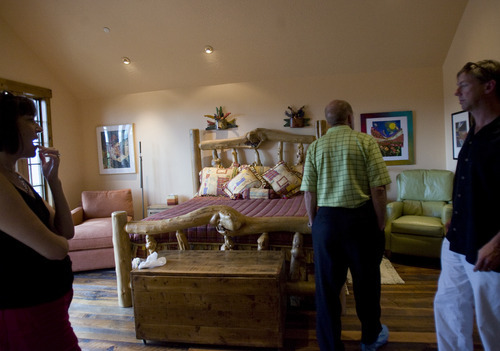 Kim Raff    The Salt Lake Tribune People tour the master bedroom of the 4,500-square-foot home on Dakota Trail in the Promontory during the Park City Showcase of Homes on September 2, 2012.